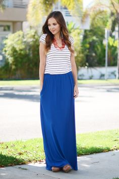 Royal blue maxi skirt, striped t shirt and statement necklace.