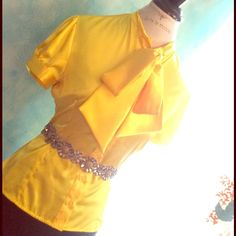 Elegant and unique blouse Eye catching yet modest retro style blouse in a gorgeous warm canari yellow. Worn once for my daughter's graduation and got so many compliments! Buttons down front and on sleeve. Collar ties into a bow easily and lies flat and elegant. Tops Blouses