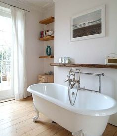 Image result for shelves next to freestanding baths
