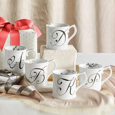 Calligraphy Mug: The letters on these elegant, black and white porcelain mugs were modeled after century calligraphy found in a European flea market. All letters except Q, U, X and Z. Boxed for gift giving. Porcelain Mugs, White Porcelain, 4 H, Decoration, Furniture Decor, 18th Century, Home Furnishings, Personalized Gifts, Calligraphy