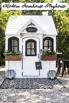 When we first bought our house, in place of a neglected side yard with overgrown rose bushes, I imagined an area where the kids could play. Not too long after that, out went the rose bushes and in … playground outdoor play areas Costco Playhouse, Backyard Playhouse, Build A Playhouse, Playhouse Ideas, Modern Playhouse, Outdoor Playhouse For Kids, Childs Playhouse, Cedar Playhouse, Outdoor Playhouses
