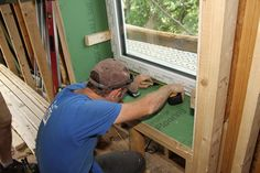 Setting High Performance Windows. JLC_Passive House.  ZIP sheathing, high-tech SIGA Wigluv tape, and a lag-screw connection through the window jamb make installing these high-performance Schuco windows a quick and painless job.