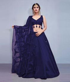 Item is Readymade. Size is 38 inches.It can be cutomized upto Bust & Waist Size 42 inches Work Type: Thread Embroidery with Flowers & Tassels Blouse Color: Navy Blue Lehenga Color: Navy Blue Dupatta Color: Navy Blue Blouse Fabric: Art Silk Lehenga Fabric: Indian Bridal Outfits, Indian Bridal Lehenga, Indian Designer Outfits, Designer Dresses, Silk Lehenga, Ghagra Choli, Plain Lehenga, Navy Blue Lehenga, Banarsi Saree