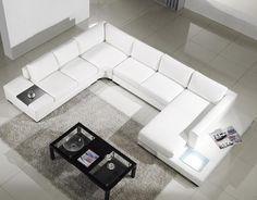 modern white bonded leather sectional sofa seats 7 and features two end tables, including one with a built in light