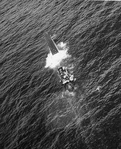 As their submarine's stern begins to sink, crewmen of U-664 break out their life rafts and abandon ship following a successful attack by TBF Avengers and F4F Wildcats of Composite Squadron from the escort carrier Card. warhistoryonline.com
