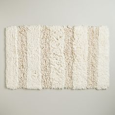 $20 http://www.worldmarket.com/product/ivory+hi-low+shag+bath+mat.do?=fn
