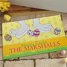 "This bright and cheery doormat will look beautiful at your front door this Easter! ... The cute bunny feet and Easter Eggs make it the perfect ""starting mat"" for the Easter Egg Hunt, too!"