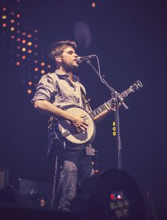 Winston MarshallofMumford & Sons performs at the Susquehanna Bank Center in Camden, New Jersey on February 16, 2013.  Photo ©E. Ashleigh/ShowtographE.