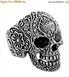 Beautiful 925 Sterling Silver Skull Biker Ring. This floral design ring is full of intricate detail. It is high polished and hand painted to bring out the detail. It is made in USA and is available in all sizes. About Us: We are one of the largest biker ring manufacturers in the