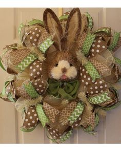 Love this wreath with the bunny in the center!  Great for welcoming spring and Easter!  It's a large, full wreath measuring approximately 25X25X9.  All the ribbon is wired so it will fluff nicely after shipping!  Check out my shop at etsy.com/shop/wrufflewreathsbylana!  Blessings!