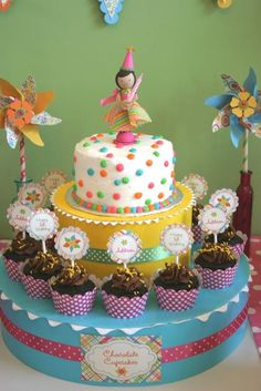 Kiara's cake, 1 tier in rose icing, princess theme w/ candles to blow. Surrounded by cupcakes to look like succeeding tiers