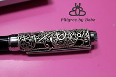 Silver filigree cover pen.