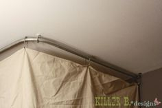 Around $4 to hide an ugly hot water heater. You need1″ conduit (at the hardware store, $1.50 for 10′)• 1″ screw eye hanger• 2- 1″ conduit brackets