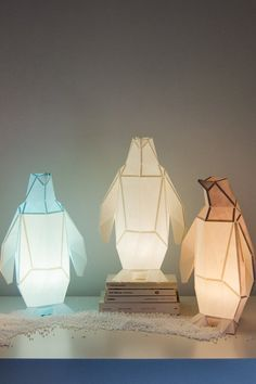 The paper penguin lamp lineup created with this DIY kit