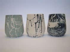 Movement Cups Slip cast beakers. Effect achived with coloured slip marbelled and drizled into a plaster mould. They capture a feeling of movement on a static surface.