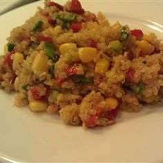Quinoa with Veggies Allrecipes.com  Reduce water to 2 C., add some chicken bullion to the water for the quinoa, and reduce olive oil to 2T.  Six servings - 4 WW points a serving and oh so good and filling!!!!!