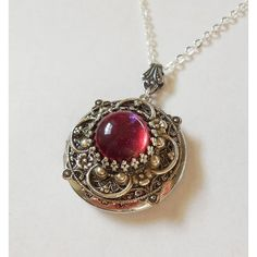 Dragon Breath Fire Opal Silver locket--silver locket ❤ liked on Polyvore featuring jewelry, pendants, jeweled crown, floral jewelry, engraved locket, engraved jewelry and engraved silver jewelry