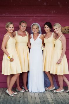 All yellow maids. Love the bride's dress (White One for Pronovias.)