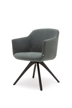 640 Chair – Office Blueprint | The sculptural form of the 640 chair from Rolf Benz is a perfect seating solution for dining, board room, and office use. The shape is reminiscent of a comfortable armchair, with its gently sloping arm rests and soft upholstery. Its striking silhouette fits in with many styles of desk or table, and the chair can be customised in several fabric and base options. | Creating Happy Offices | Sound Proof Acoustic Phone Booths | Framery UK & Office Blueprint