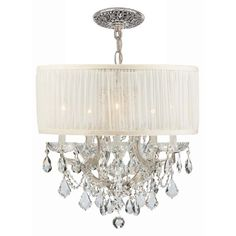 This isn't your Grandmother's crystal. The Brentwood Collection from Crystorama offers a nice mix of traditional lighting designs with large tailored encompassing shades. Adding either the Harvest Gold, smooth sheer white or ivory Antique shade to these best selling skus opens the door to possibilities for these designer friendly chandeliers. The Brentwood Collection has a touch of design flair that will work for your traditional or transitional home.