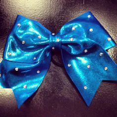 Cheerleading hair bow perfect for all styles of hair blonde brunette curly or straight hair  only at Capital Cheer Michigan