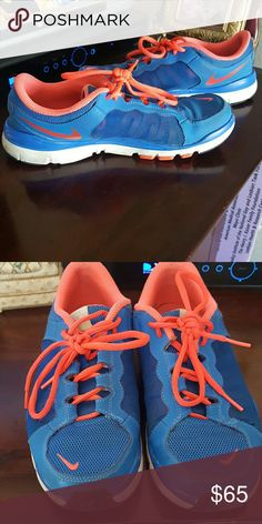 BOGO 1/2 OFF NIKE Flex Trainers 2 Great condition bright nikes. Flex Trainers 2 lightweight. Mesh accent on the sides. Hot pink and neon blue. NO TRADES Nike Shoes Athletic Shoes