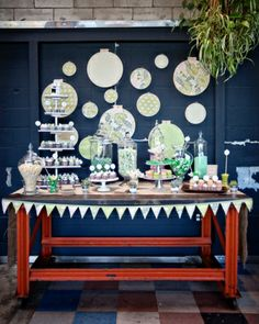 Fabric bunting adorned the table of treats at Joo and Jacob's wedding. Embroidery hoops fitted with patterned fabric created a fun background.