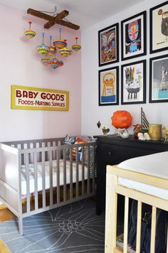 Nice vintage modern nursery.  The graphic prints on the wall have a hip vibe, and the mobile made from old tops is cool too.