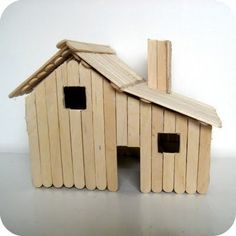 Little House on the Prairie House made out of popsicle sticks - complete with ladder and loft. From dee*construction.