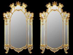 A spectacular and grand scaled pair of mid 18th century, circa. 1740, Tuscan giltwood mirrors. The pair with all original gilt and mirror plates has a sensation pierced triple frame design embellished by scrolled floral garlands amidst the top central reserve while the bottom scalloped design has two 'C' scrolled supports. Exceptional quality and proportions throughout.