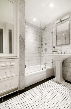 Basket Weave Tiles, Custom Cabinets, Marble Tiles, Small Bathrooms, tiles, pedestal sink, bathroom lighting, bathroom storage, tub and shower, tiled floor, grey tiles, sconce,
