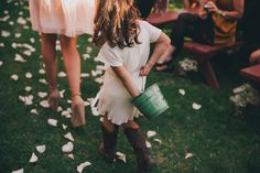 Tossing flowers behind her back.