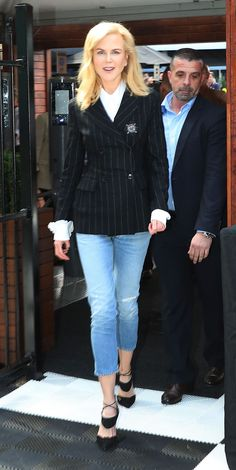 Look of the Day - Nicole Kidman dresses up her denin with a hero nautical blazer and heels. We absolutely love this for the way she's styled it; buttoned up with a flash on a ruffled shirt cuff. from InStyle.com