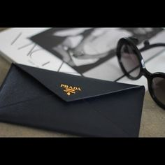 Prada Envelope Clutch It's no denying that this is the perfect clutch to take out on a date or a night out on the town. This is sophisticated and luxurious, as well as smart and compact. Can fit up to an iPhone 6+ along with credit cards and a lipstick. Absolutely NO TRADES. Price is firm. This is Authentic, I bought 2 one for me and one for you! ;-) comes with all papers. BRAND NEW STILL IN PACKAGING!! Prada Bags Clutches & Wristlets