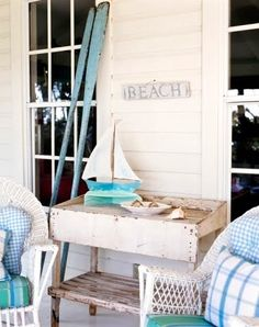 The weathered beach décor on this lovely porch add to the relaxing, summer atmosphere. For more ideas on Beach Cottage Style: Outdoor Spaces, go to http://decoratingfiles.com/2012/07/beach-cottage-style-outdoor-spaces/