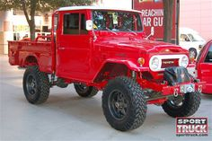 An Old Toyota Landcruiser Truck... my hubby and I have wanted this exact car forever!  We will have it oneday...