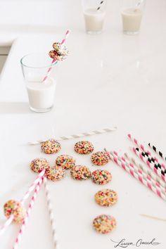 mini cookies on paper straws