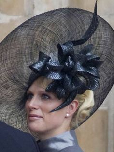 Zara Phillips, the Queen's granddaughter, arrives at William and Kate's wedding wearing an intricate Philip Treacy hat.