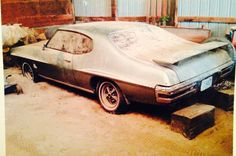 Brad managed to take one photo of the GTO Judge, covered with dust, in the barn where it resided for... - Provided by Hotrod