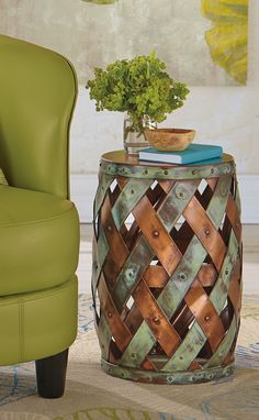 Our copper-plated Verona Copper Table features a hand-hammered tabletop riveted to a woven, mixed-finish base.