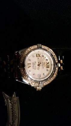 Brightling ladies wings watch 5ct diamond yellow gold and stainless.
