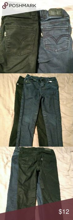 Little girl's size 7 Levi's skinny jeans 2 pairs Two pairs girl's Levi's denim: Blue with purple sparkles and smooth black. Excellent condition. Both have some stretch and an adjustable waistband. Levi's Bottoms Jeans