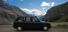 A 'black taxi' climbing the Stelvio Pass in Italy