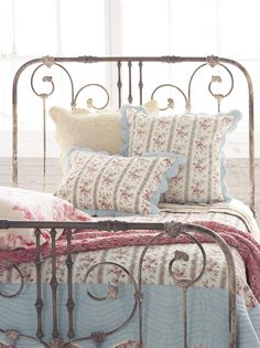 More interested in the wrought iron bed than the quilt.