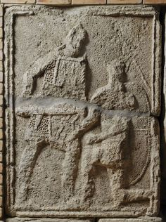 Adamclisi Metope. Legionary with sword drawn standing over kneeling Dacian warrior with shield at his back.