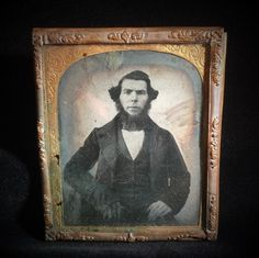 A personal favorite from my Etsy shop https://www.etsy.com/listing/222168156/photo-portrait-antique-tin-type-half