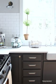 Paint colors: Wall: Polished Gray {Glidden} Ceiling: Polished Limestone {Glidden} Upper Cabinets & Plank walls: Dove White {Benjamin Moore} Lower Cabinets: Kendall Charcoal {Benjamin Moore}