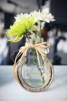 Mason jars and Horseshoes farm country wedding centerpiece