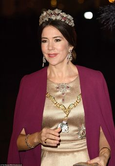 All that glitters: Mary wore the Ruby Parure Tiara and matching jewels as well as the Orde...