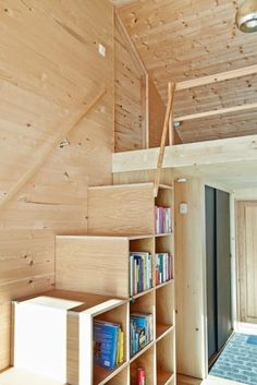 modern danish cabin, all wood, bookshelf stairs